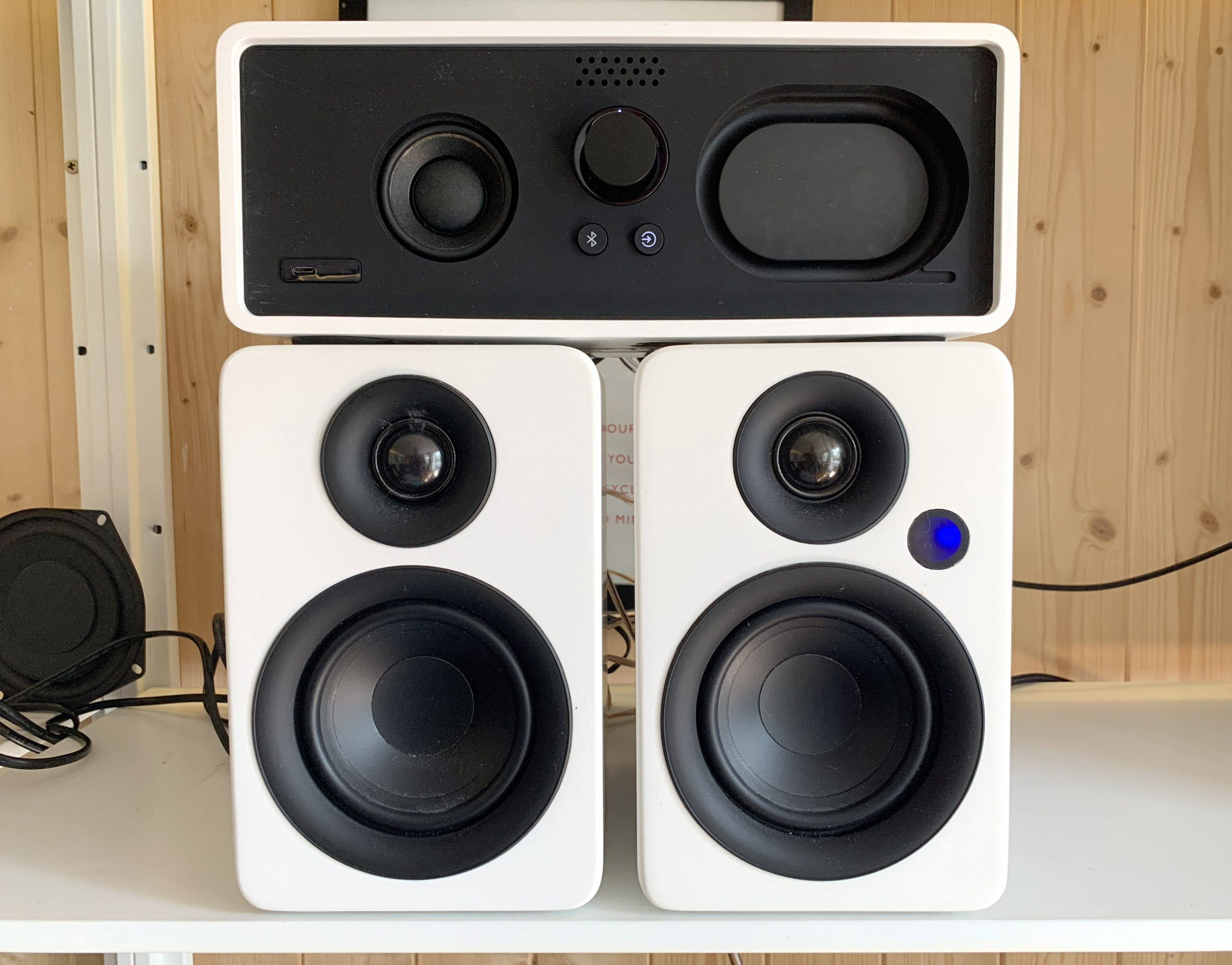 Dock E30 sitting atop a pair of reference stereo speakers